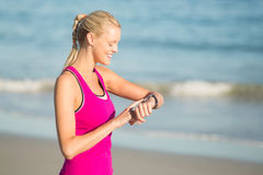 Woman checking time on beach Royalty Free Stock Photo