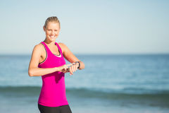 Woman checking time on beach Royalty Free Stock Photography