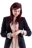 Woman checking time Stock Photography