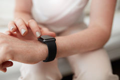 Woman checking time on her smart watch Royalty Free Stock Image
