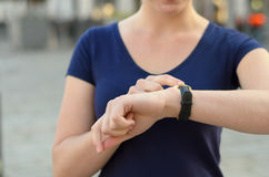 Woman checking the time on her smartwatch Stock Images