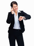 Woman checking time while using a cell phone Stock Photo