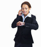 Woman checking time while using cellphone Royalty Free Stock Photos
