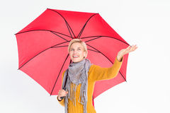 Woman checking to see if its raining Royalty Free Stock Photo