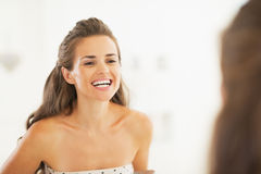 Woman checking tooth in bathroom Stock Image