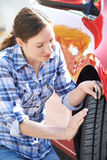 Woman Checking Tread On Car Tyre With Gauge Stock Image
