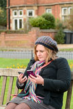 Woman checking two mobile phones Royalty Free Stock Photos