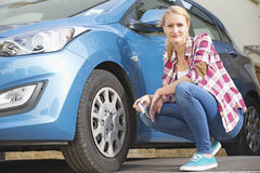Woman Checking Tyre Pressure On Car.  Royalty Free Stock Photos