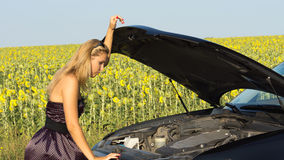 Woman Checking Under The Hood Royalty Free Stock Photos