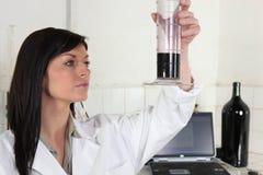 Woman checking wine Royalty Free Stock Photo