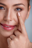 Woman checking wrinkles around the eyes Royalty Free Stock Photography