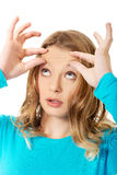 Woman checking wrinkles on forehead Stock Image