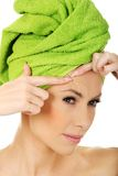 Woman checking wrinkles on her forehead. Royalty Free Stock Photo