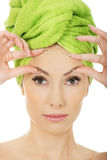 Woman checking wrinkles on her forehead. Royalty Free Stock Images