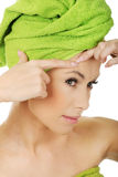 Woman checking wrinkles on her forehead. Stock Photos