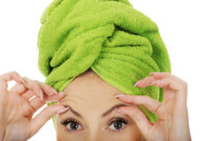 Woman checking wrinkles on her forehead. Stock Photo
