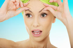 Woman checking wrinkles on her forehead. Stock Images