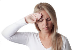 Woman checks fever on forehead isolated on white Royalty Free Stock Photography