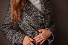 Woman checks her coat Royalty Free Stock Photos