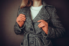 Woman checks her coat Stock Photos