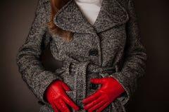 Woman checks her coat Stock Photo