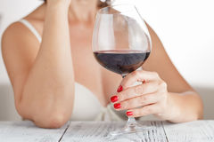 Woman checks red wine Royalty Free Stock Photo