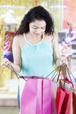Woman checks shopping bags in the fashion boutique Stock Image