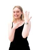 Woman checks time on her wrist watch Stock Photo
