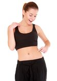 Woman checks the waist fatness on white Royalty Free Stock Photo