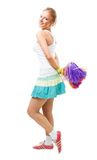 Woman cheer leader dance and smile. Young positive woman cheer leader with pompoms dance and smile, isolated on white Royalty Free Stock Images