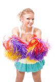 Woman cheer leader shaking pompoms. Woman cheer leader shake pompoms smile and look at camera Royalty Free Stock Photo