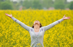 Woman cheering Stock Images
