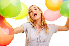 Woman cheering with balloons Stock Photo