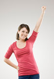 Woman cheering and celebrating her success Stock Images