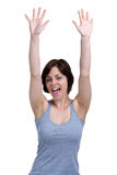 Woman cheering with her hands in the air royalty free stock images
