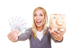 Woman cheering with money Stock Photo