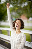 Woman Cheering At The Park Royalty Free Stock Images