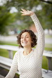 Woman Cheering At The Park Royalty Free Stock Image