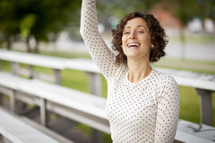 Woman Cheering At The Park Stock Image