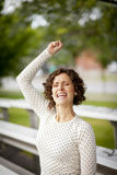 Woman Cheering At The Park Stock Images