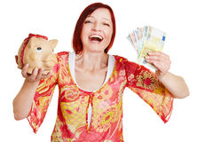 Woman cheering with piggy bank Royalty Free Stock Photo