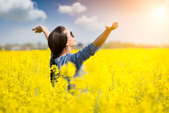 Woman cheering in the rape field Royalty Free Stock Photos