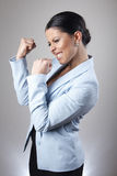 Woman cheering victoriously Royalty Free Stock Photos