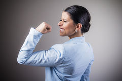 Woman cheering victoriously Stock Photos