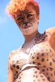 Woman cheetah face stock images