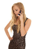 Woman cheetah print dress phone talk look down Stock Photos