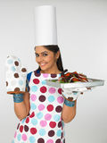 Woman chef with baked chicken. Asian woman chef with baked chicken royalty free stock images