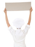 Woman chef, baker or cook holding blank board Stock Photography