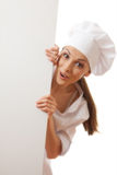 Woman chef, baker or cook holding white paper sign Stock Image