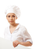 Woman chef, baker or cook holding white paper sign Royalty Free Stock Photography